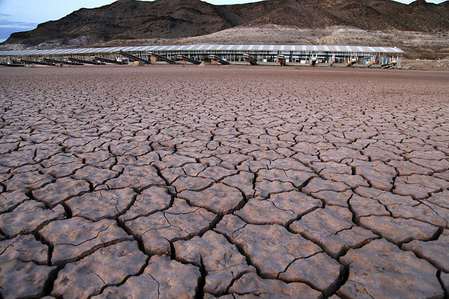 In this July 16, 2014 photo, what was once the Echo Bay Marina sits high and dry next to Lake Mead in the Lake Mead National Recreation Area in Nevada. A 14-year drought has caused the water level in Lake Mead to shrink to its lowest point since it was first filled in the 1930s. (AP Photo/John Locher)