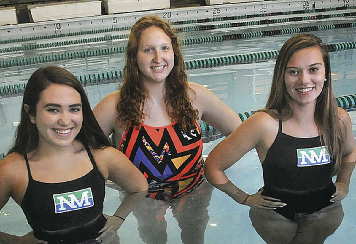 Hour photo/Matthew Vinci Norwalk-Brien McMahon co-op girls swim captains for this fall are, from left, Claire Keller from McMahon, Lindsey Dell-Isola from Norwalk, and Olivia Begos from McMahon.