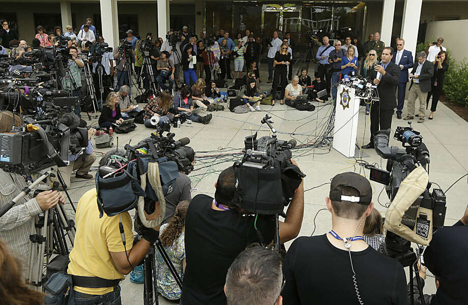 Lt. Keith Boyd, assistant chief deputy coroner for the Marin County Sheriff's Office, at podium, speaks at a news conference about the death of Robin Williams in San Rafael, Calif., Tuesday, Aug. 12, 2014. Boyd said Tuesday that Williams killed himself by hanging himself with a belt at his San Francisco-area home. (AP Photo/Jeff Chiu)