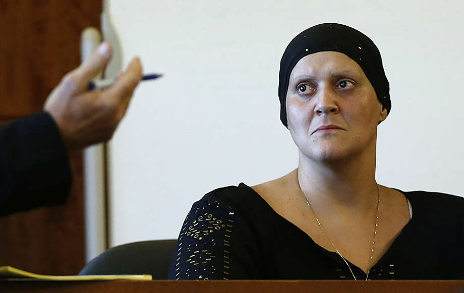Tanya Singleton sits on the witness stand as her lawyer E. Peter Parker speaks during a hearing in Fall River Superior Court in Fall River, Mass., Tuesday, Aug. 12, 2014. Singleton, a cousin of former New England Patriots football player Aaron Hernandez, pled guilty to criminal contempt in connection with the investigation of murder charges against Hernandez. (AP Photo/Michael Dwyer, Pool)
