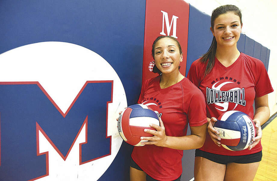 Hour photo/John NashBrien McMahon volleyball captains Molly Fusarelli, left, a senior setter, and junior outside hitter Meredith Pellegrino will lead the Senators this fall season.