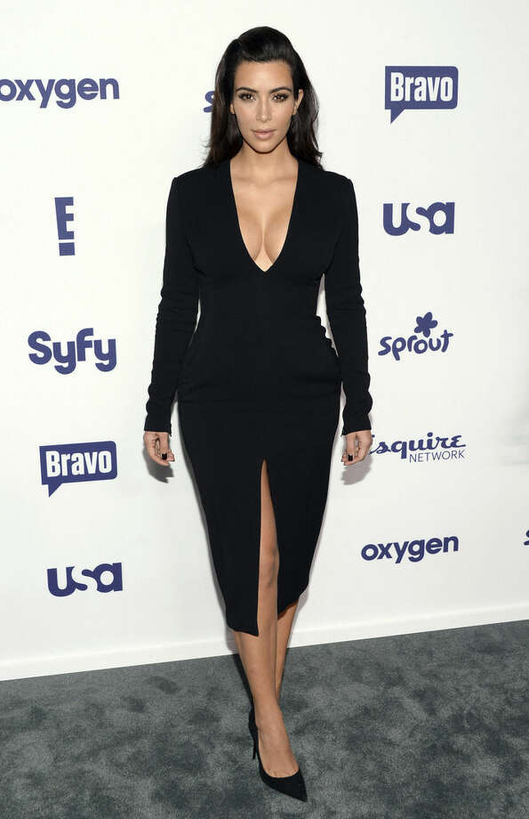 "FILE - This May 15, 2014 file photo shows Kim Kardashian at the NBCUniversal Cable Entertainment 2014 Upfront in New York. Viewers will be able to see parts of Kardashian's wedding to Kanye West in two upcoming ""Keeping Up with the Kardashians"" episodes, airing Sunday, Aug. 31 and Monday Sept. 1 on E! (Photo by Evan Agostini/Invision/AP, File)"