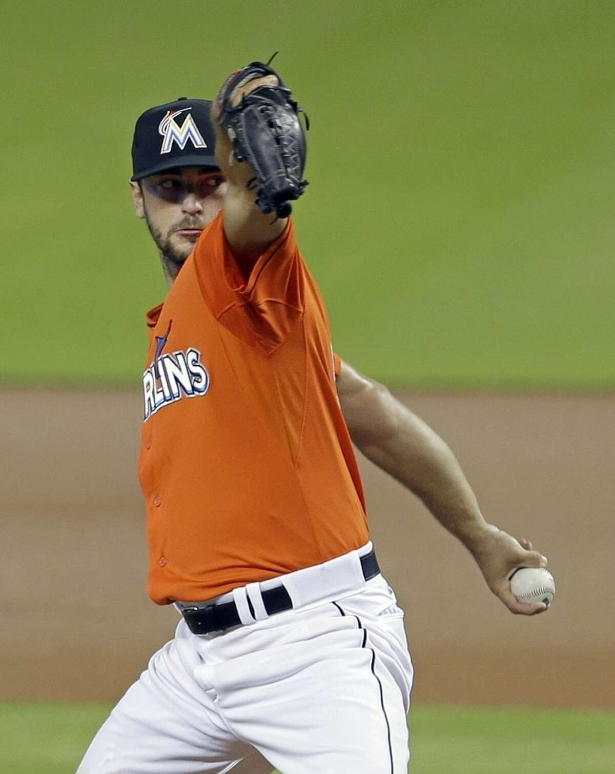 Miami Marlins' Jarred Cosart pitches against the New York Mets in the first inning of a baseball game, Sunday, Sept. 6, 2015, in Miami. (AP Photo/Alan Diaz)