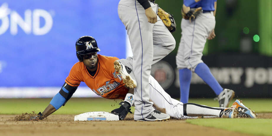 Miami Marlins' Dee Gordon steals second base in the first inning of a baseball game against the New York Mets, Sunday, Sept. 6, 2015, in Miami. (AP Photo/Alan Diaz)