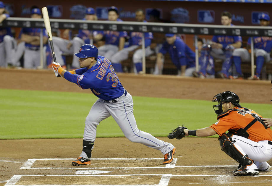 New York Mets' Michael Conforto (30) follows through on a double against the Miami Marlins in the first inning of a baseball game, Sunday, Sept. 6, 2015, in Miami. (AP Photo/Alan Diaz)