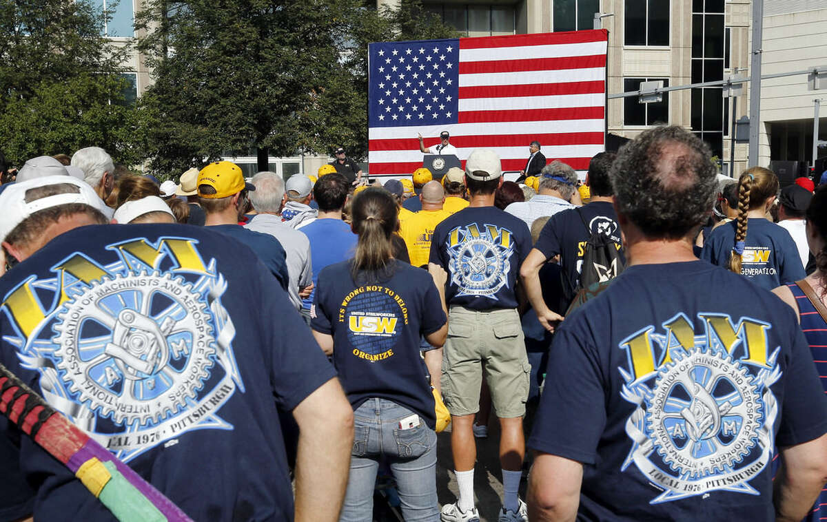 """A crowd gathers, many wearing union shirts, in front of Vice President Joe Biden as he speaks before joining in the annual Labor Day parade on Monday, Sept. 7, 2015, in Pittsburgh. Hearing chants of """"run Joe, run,"""" Biden marched in Pittsburgh's annual Labor Day parade on Monday as speculation swirled about a potential late entry into the Democratic presidential campaign. (AP Photo/Keith Srakocic)"""