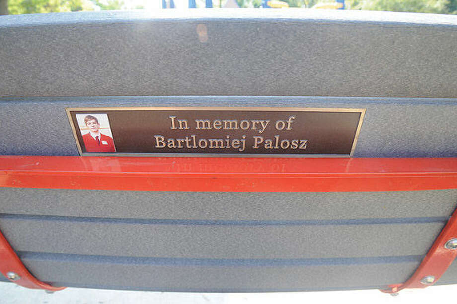 """Norwalk middle school parent Lori Keegan has created a """"buddy bench""""at Cranbury Elementary to raise awareness for suicide prevention. The bench is dedicated on the back to Greenwich student Bartlomiej Palosz who took his life. Hour photo/Matthew Vinci"""