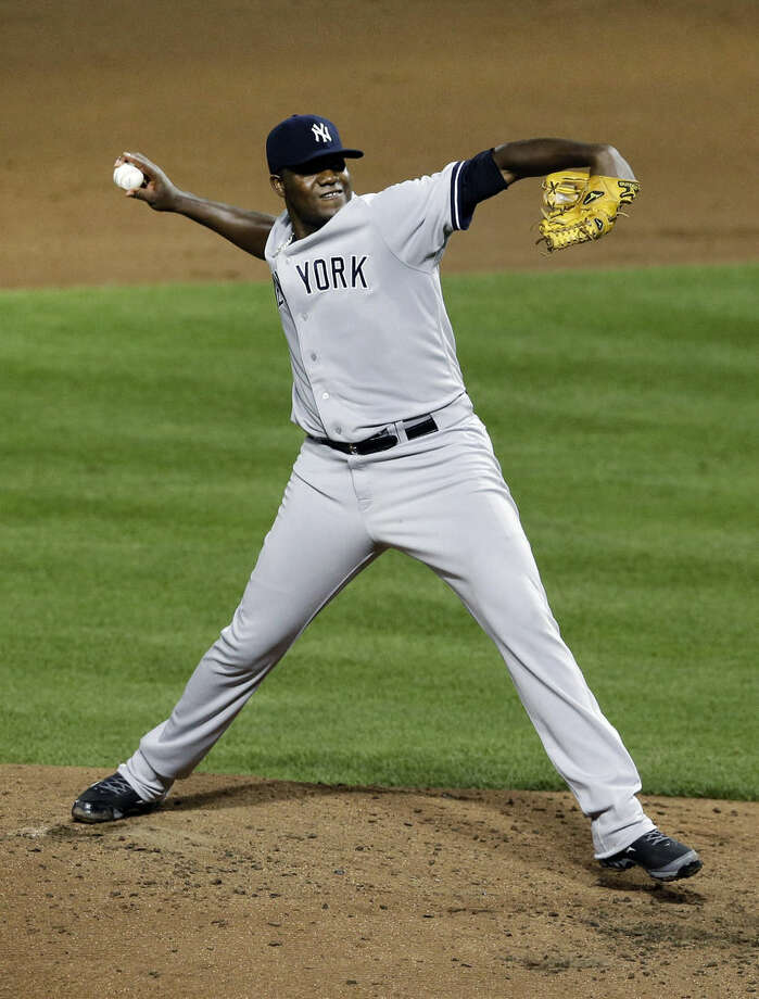 New York Yankees starting pitcher Michael Pineda throws to the Baltimore Orioles in the fifth inning of a baseball game, Wednesday, Aug. 13, 2014, in Baltimore. (AP Photo/Patrick Semansky)