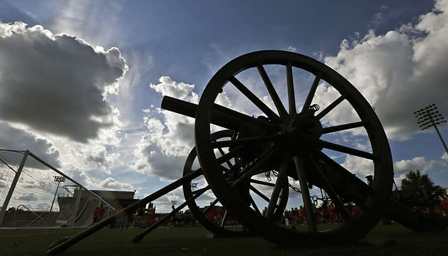 A cannon used by the Virginia Tech Corp of Cadets to celebrate when the school scores stands ready in front of Lane Stadium before an NCAA college football game against Ohio State in Blacksburg, Va., Monday, Sept. 7, 2015. (AP Photo/Steve Helber)