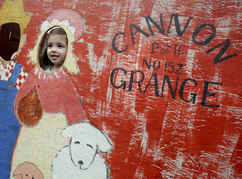Hour photo/Matthew VinciCailfhionn Mitchell 4, at the Cannon Grange 80th annual agricultural fair in Wilton in 2012.