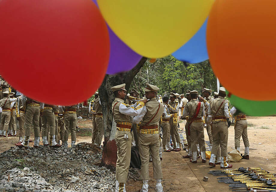 Balloons fly at the National Industrial Security Academy (NISA) as members of India's Central Industrial Security Force (CISF) prepare for a ceremonial parade on the outskirts of Hyderabad, India, Tuesday, Sep. 8, 2015. The CISF is a paramilitary security force which provides security cover to nuclear installations, space establishments, airports, seaports, power plants, sensitive Government buildings and heritage monuments in India. (AP Photo/Mahesh Kumar A.)