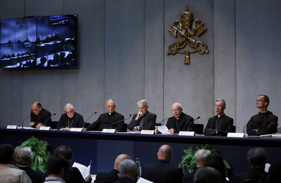 Cardinal Francesco Coccopalmerio, third from right, speaks during a press conference to illustrate a new law issued by Pope Francis regulating how bishops around the world determine when a fundamental flaw has made a marriage invalid, at the Vatican, Tuesday, Sept. 8, 2015. Pope Francis radically reformed the Catholic Church's process for annulling marriages Tuesday, allowing for fast-track decisions and removing automatic appeals in a bid to speed up and simplify the procedure. (AP Photo/Riccardo De Luca)