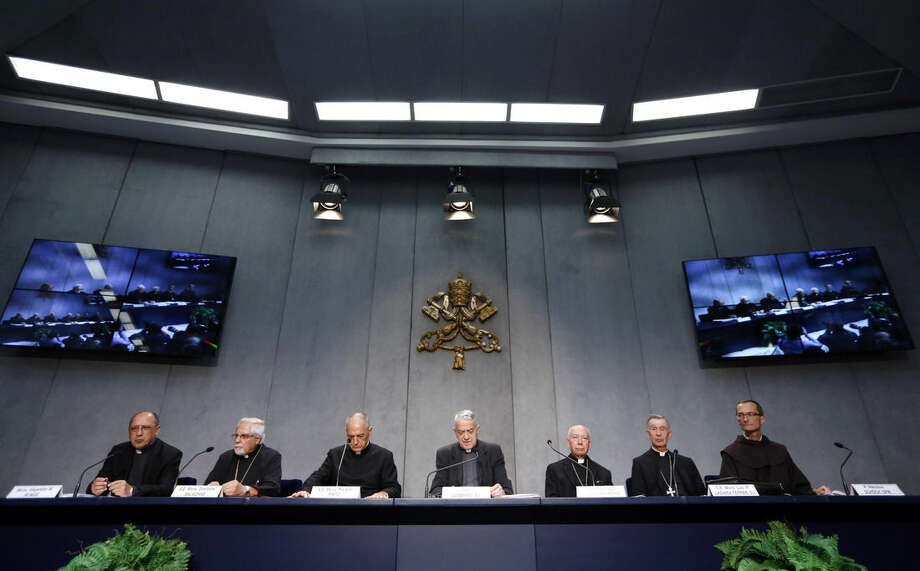 From left, Monsignor Alejandro W. Bunge, Monsignor Dimitrios Salachas, Monsignor Pio Vito Pinto, Vatican spokesperson Father Federico Lombardi, Cardinal Francesco Coccopalmerio, Monsignor Luis Francisco Ladaria Ferrer and Rev. Nikolaus Schoch meet the media to illustrate a new law issued by Pope Francis regulating how bishops around the world determine when a fundamental flaw has made a marriage invalid, at the Vatican, Tuesday, Sept. 8, 2015. Pope Francis radically reformed the Catholic Church's process for annulling marriages Tuesday, allowing for fast-track decisions and removing automatic appeals in a bid to speed up and simplify the procedure. (AP Photo/Riccardo De Luca)