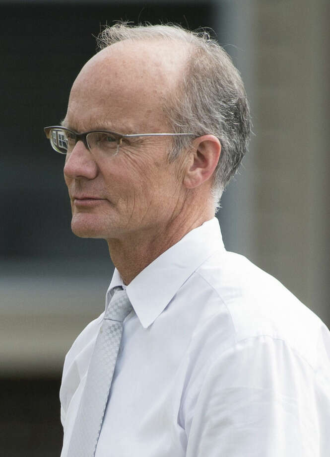 Walter Palmer arrives at River Bluff Dental clinic in Bloomington, Minn., Tuesday, Sept. 8, 2015. The Minnesota dentist who killed Cecil the lion returned to work Tuesday after weeks away, walking silently past a swarm of media and a handful of protesters outside his small dental practice calling for him to be sent to Zimbabwe to face trial. (AP Photo/Craig Lassig)