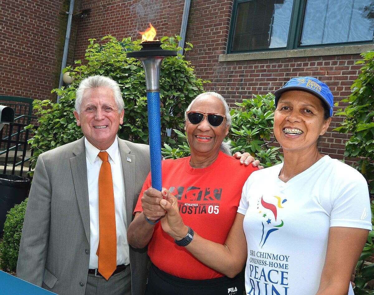 Hour Photo/Alex von Kleydorff Mayor Harry Rilling, Mary Roman and Aparanji Telles from Brazil with the torch at Peace Run in Norwalk