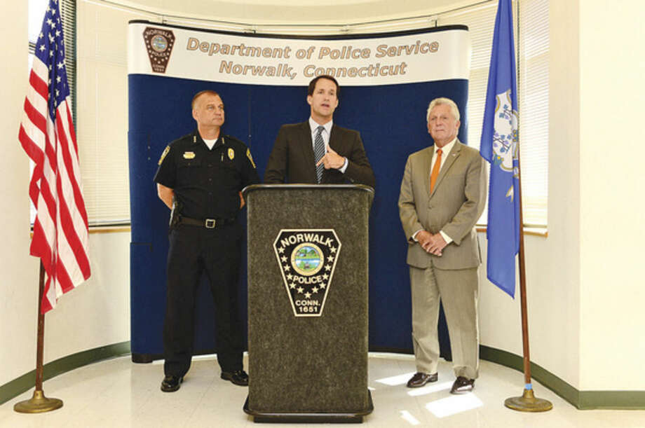 Hour photo / Erik Trautmann US Congressman Jim Himes joins Mayor Harry Rilling and Police Chief Thomas E. Kulhawik in announcing the $41,249 Edward Byrne Memorial Justice Assistance Grant the City of Norwalk received to enhance police visibility in high-crime areas and improve motor vehicle law compliance during a press conference at police headquarters Thursday