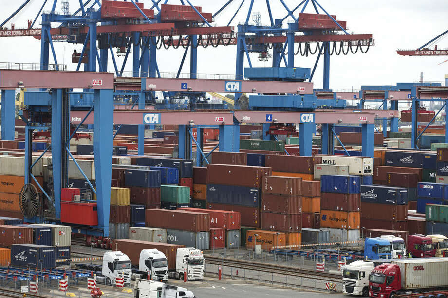 FILE - The June 16, 2014 file photo shows containers in the Hamburg, northern Germany, harbour. The shaky economic recovery in the 18-country eurozone ground to a halt in the second quarter amid fears over the crisis in Ukraine and softer trade and investment. The main reasons behind the flat outcome was a 0.2 percent quarterly decline in Germany, Europe's biggest economy, Eurostat reported Thursday, Aug. 14, 2014. (AP Photo/dpa, Christian Charisius)