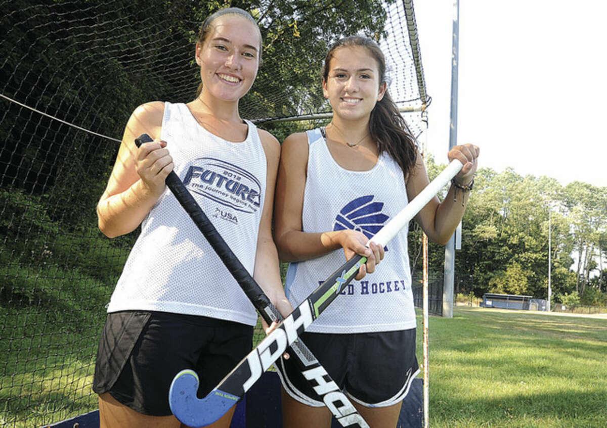 Hour photo/Matthew Vinci Wilton High field hockey captains, from left, are Jillian Mahon and Amanda Hendry.