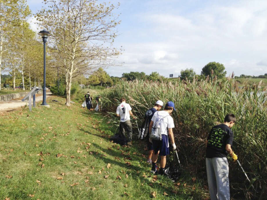 Contributed file photoVolunteers clean up Oyster Shell Park last year.