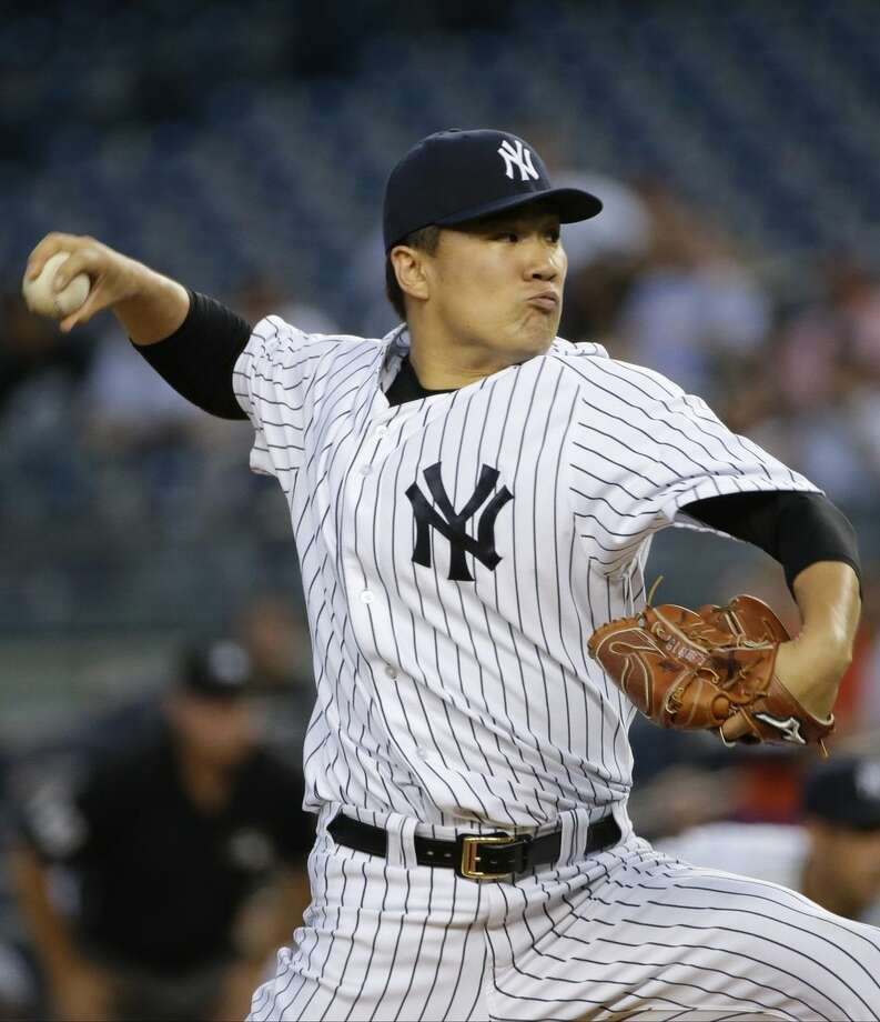 New York Yankees' Masahiro Tanaka, of Japan, delivers a pitch during the first inning of a baseball game against the Baltimore Orioles on Tuesday, Sept. 8, 2015, in New York. (AP Photo/Frank Franklin II)