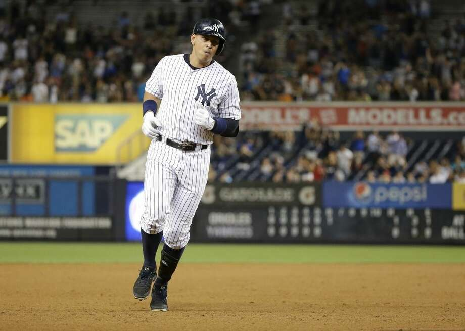New York Yankees' Alex Rodriguez runs the bases after hitting a home run during the sixth inning of a baseball game against the Baltimore Orioles on Tuesday, Sept. 8, 2015, in New York. (AP Photo/Frank Franklin II)