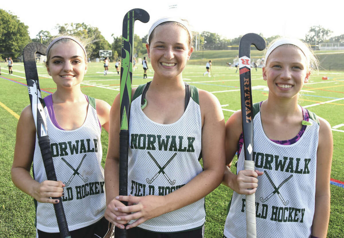 Hour photo/John Nash Norwalk High field hockey captains are, from left, Sarah Roddy, Alex Whalen and Lauren Capone.