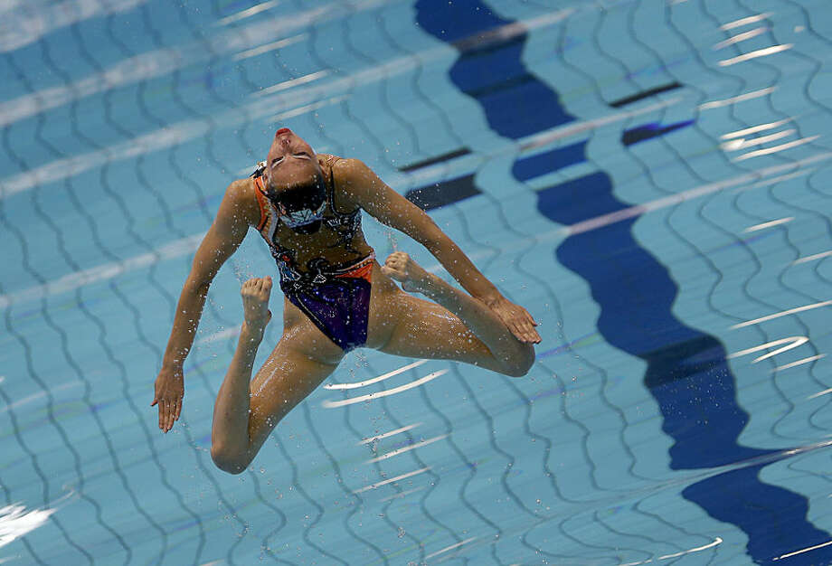 A member of team Belarus is thrown up in the air during the team synchronized swimming technical routine at the LEN Swimming European Championships in Berlin, Germany, Wednesday, Aug. 13, 2014. (AP Photo/Michael Sohn)