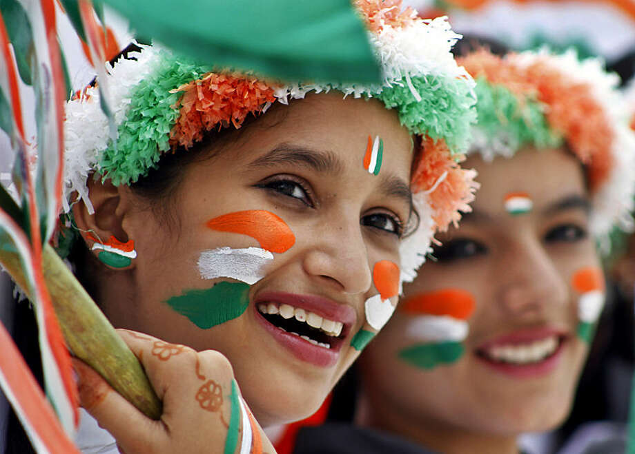 Schoolgirls dressed in the colors of the Indian national tricolor flag participate in rehearsals for Independence Day celebrations in Ajmer, India, Wednesday, Aug. 13, 2014. Independence Day is celebrated in the country annually on Aug. 15. (AP Photo/Deepak Sharma)