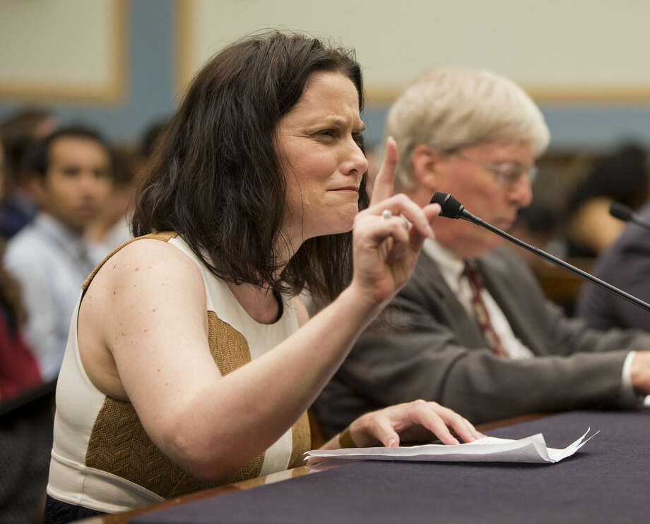 Gianna Jessen, pro-life and disability rights activist, from Franklin, Tenn., left, testifies before the House Judiciary Committee hearing at the Capitol in Washington examining the abortion practices of Planned Parenthood, Wednesday, Sept. 9, 2015. Sitting next to Jessen is James Bopp Jr., right, from the National Right to Life. Today's hearing is Congress' first since the Center for Medical Progress, a small group of anti-abortion activists, began releasing videos in July showing Planned Parenthood officials casually describing how they sometimes obtain tissue from aborted fetuses for medical researchers. Backed by analysts it hired, Planned Parenthood has said the videos were dishonestly edited to distort its officials' remarks and has denied any wrongdoing. (AP Photo/Pablo Martinez Monsivais)