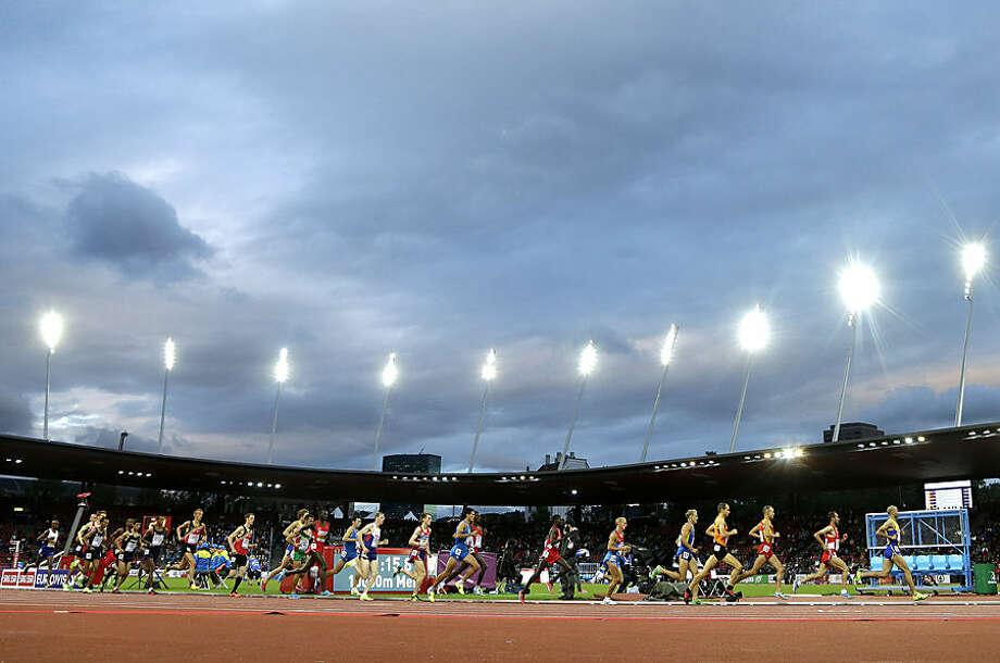 Athletes run in the 10 000m final during the European Athletics Championships in Zurich, Switzerland, Wednesday, Aug. 13, 2014. (AP Photo/Petr David Josek)