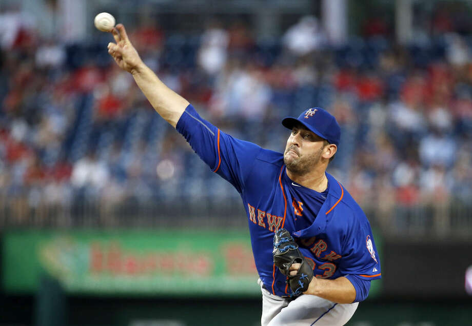 New York Mets starting pitcher Matt Harvey throws during the first inning of a baseball game against the Washington Nationals at Nationals Park, Tuesday, Sept. 8, 2015, in Washington. (AP Photo/Alex Brandon)