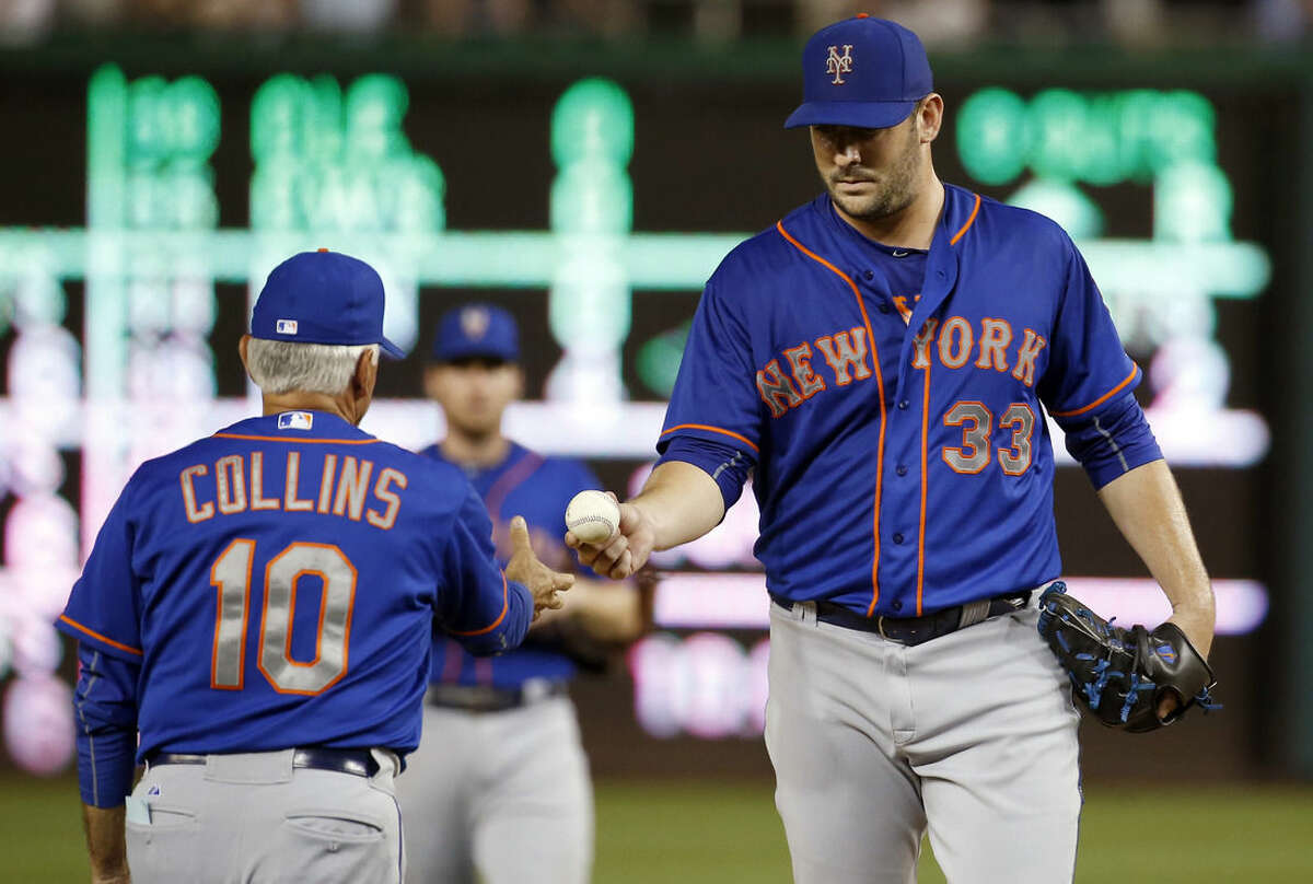 New York Mets manager Terry Collins (10) removes starting pitcher Matt Harvey (33) during the sixth inning of a baseball game against the Washington Nationals at Nationals Park, Tuesday, Sept. 8, 2015, in Washington. (AP Photo/Alex Brandon)