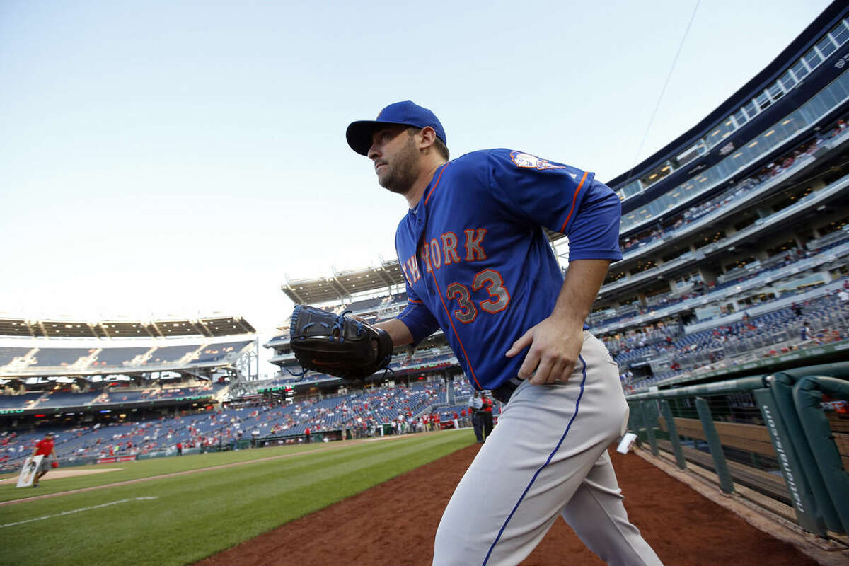 New York Mets starting pitcher Matt Harvey takes the field to warm up before the Mets' baseball game against the Washington Nationals at Nationals Park, Tuesday, Sept. 8, 2015, in Washington. (AP Photo/Alex Brandon)