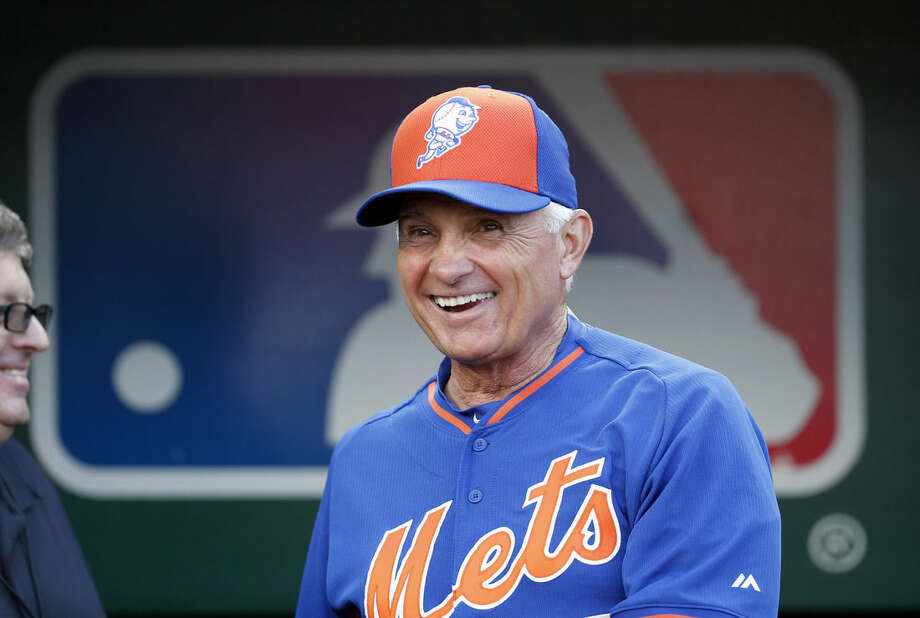 New York Mets manager Terry Collins smiles as he steps out of the dugout before a baseball game against the Washington Nationals at Nationals Park, Tuesday, Sept. 8, 2015, in Washington. (AP Photo/Alex Brandon)