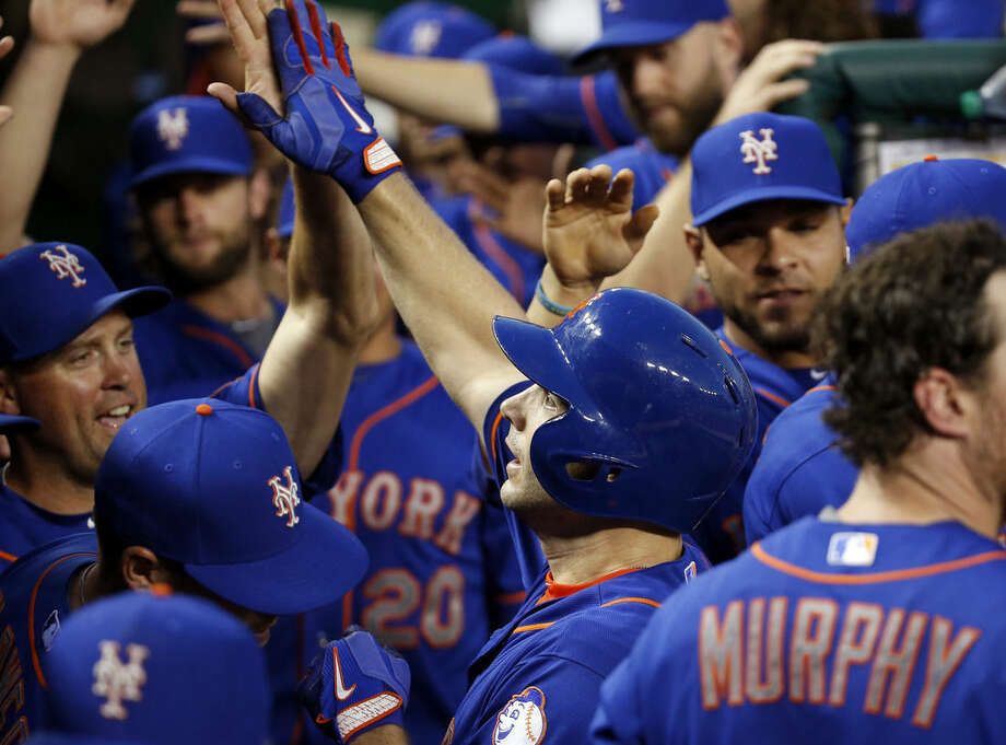 New York Mets' David Wright, center in helmet, celebrates his solo home run with his teammates during the second inning of a baseball game against the Washington Nationals at Nationals Park, Tuesday, Sept. 8, 2015, in Washington. (AP Photo/Alex Brandon)