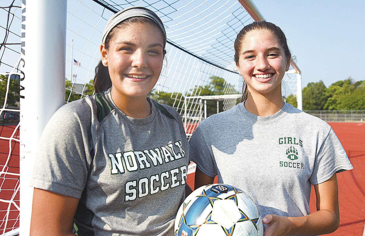 Hour photo/John Nash - Norwalk girls soccer captains for 2015 include Paulina Mandujano, left, and Hannah Froelich.
