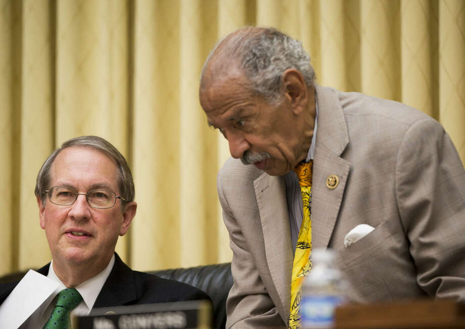 Rep. Bob Goodlatte, R-Va., left, Chairman, House Committee on the Judiciary, talks with Democratic Ranking Member Rep. John Conyers, Jr., D-Mich., right, before the start of their hearing at the Capitol in Washington examining the abortion practices of Planned Parenthood, Wednesday, Sept. 9, 2015. Today's hearing is Congress' first since the Center for Medical Progress, a small group of anti-abortion activists, began releasing videos in July showing Planned Parenthood officials casually describing how they sometimes obtain tissue from aborted fetuses for medical researchers. Backed by analysts it hired, Planned Parenthood has said the videos were dishonestly edited to distort its officials' remarks and has denied any wrongdoing. (AP Photo/Pablo Martinez Monsivais)