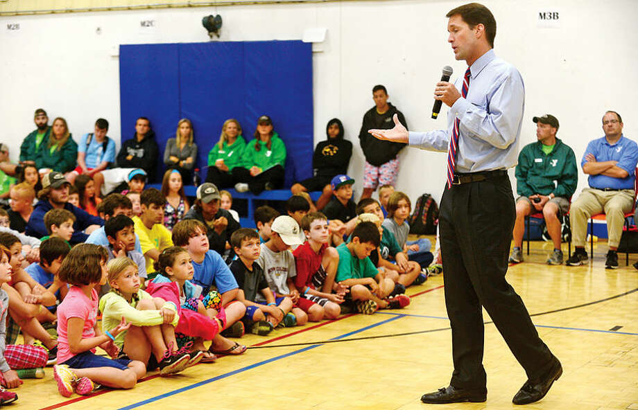 """Hour photo / Erik Trautmann US Congressman Jim Himes speaks at the Y's """"Delete Cyberbullying"""" event, sponsored by Cablevision's """"Power to Learn"""" program, Wednesday morning at the Wilton YMCA summer camp."""