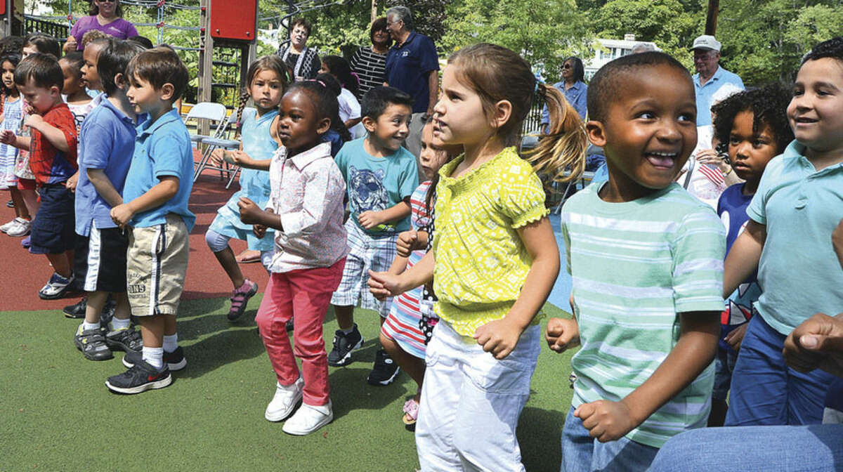 Hour Photo/Alex von Kleydorff Kids with The Marvin Childrens Center jump for peace during a program with The Peace Run