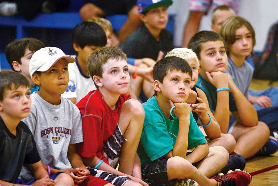 """Hour photo / Erik Trautmann Summer campers listen to US Congressman Jim Himes as he speaks at Y's """"Delete Cyberbullying"""" event, sponsored by Cablevision's """"Power to Learn"""" program, Wednesday monring at the Wilton YMCA."""