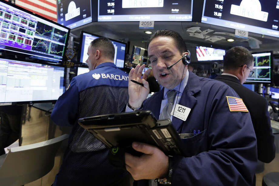 Trader Tommy Kalikas, center, works on the floor of the New York Stock Exchange, Wednesday, Sept. 9, 2015. U.S. stocks are opening solidly higher as investors take their cue from big gains in Asia and Europe. (AP Photo/Richard Drew)