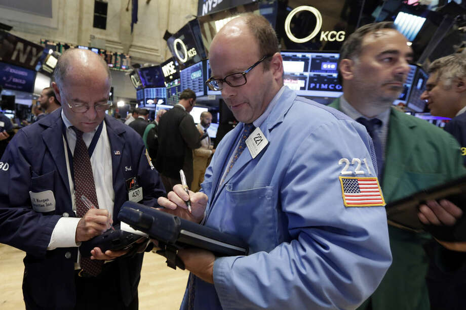 Trader Peter Mancuso, center, works on the floor of the New York Stock Exchange, Wednesday, Sept. 9, 2015. U.S. stocks are opening solidly higher as investors take their cue from big gains in Asia and Europe. (AP Photo/Richard Drew)