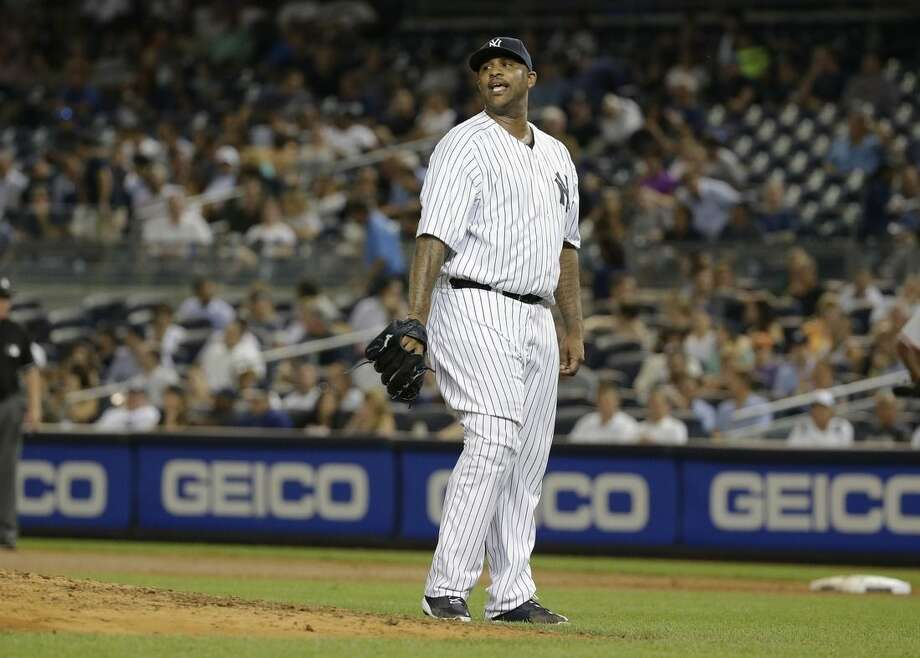 New York Yankees starting pitcher CC Sabathia reacts after hitting Baltimore Orioles' Chris Davis with a pitch during the fifth inning of a baseball game Wednesday, Sept. 9, 2015, in New York. (AP Photo/Frank Franklin II)