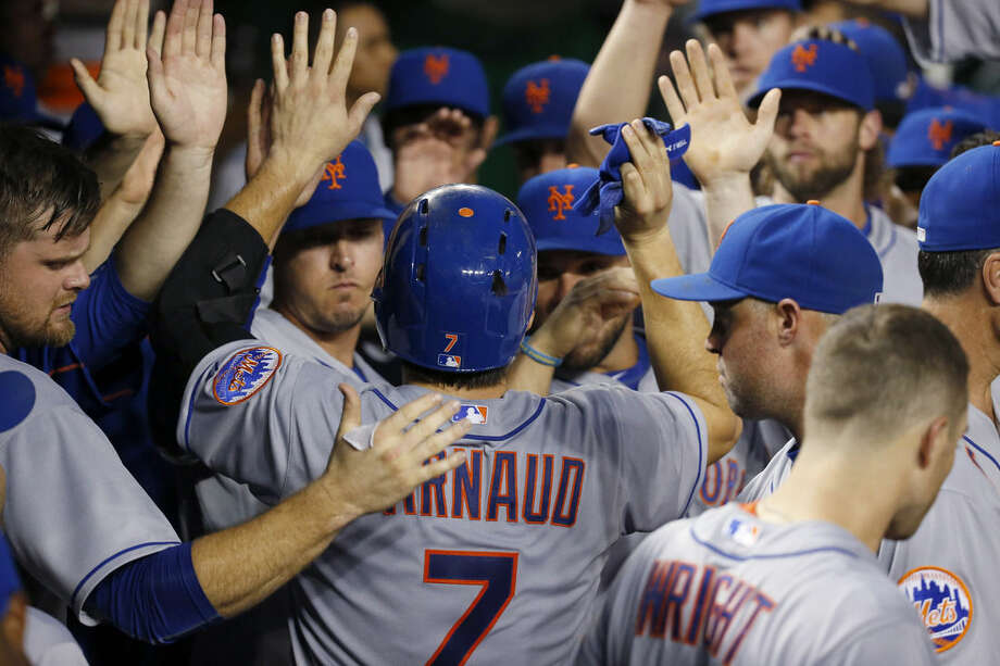 New York Mets' Travis d'Arnaud (7) celebrates his solo home run during the second inning of a baseball game against the Washington Nationals at Nationals Park, Wednesday, Sept. 9, 2015, in Washington. (AP Photo/Alex Brandon)