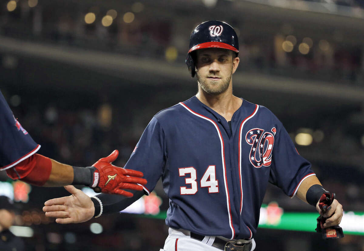 Washington Nationals' Bryce Harper celebrates after scoring on a single by Clint Robinson during the fourth inning of a baseball game against the New York Mets at Nationals Park, Wednesday, Sept. 9, 2015, in Washington. (AP Photo/Alex Brandon)