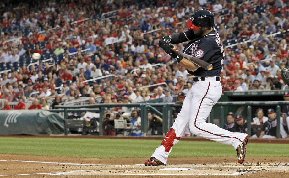 Washington Nationals' Bryce Harper swings on a solo home run during the first inning of a baseball game against the New York Mets at Nationals Park, Wednesday, Sept. 9, 2015, in Washington. (AP Photo/Alex Brandon)