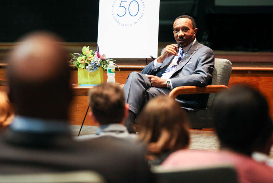 """Hour photo/Chris Palermo. Kweisi Mfume speaks with students before his community lecture and conversation on """"The Relevance of Community Colleges Today"""" at Norwalk Community College Wednesday evening."""