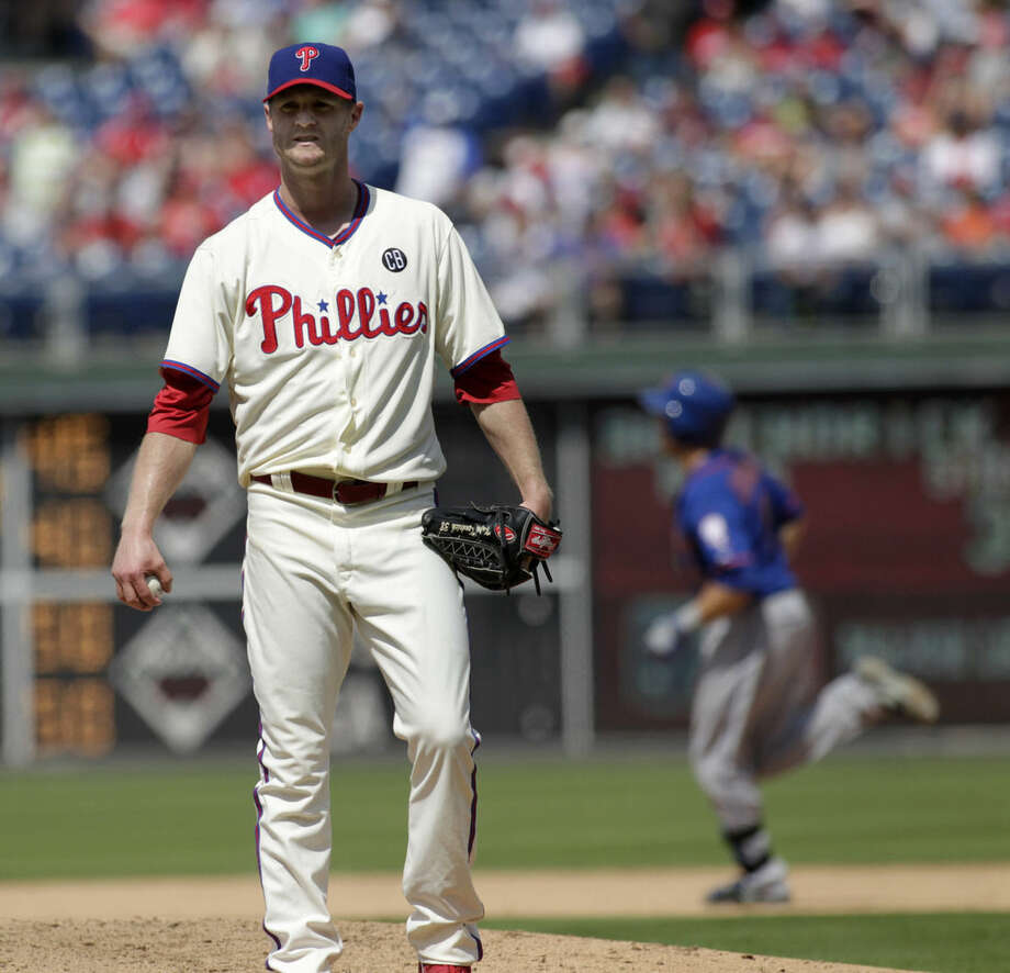 Philadelphia Phillies starting pitcher Kyle Kendrick stands on the mound after New York Mets' Travis d'Arnaud hit a solo home run in the fifth inning of a baseball game Sunday, Aug. 10, 2014, in Philadelphia. (AP Photo/H. Rumph Jr)
