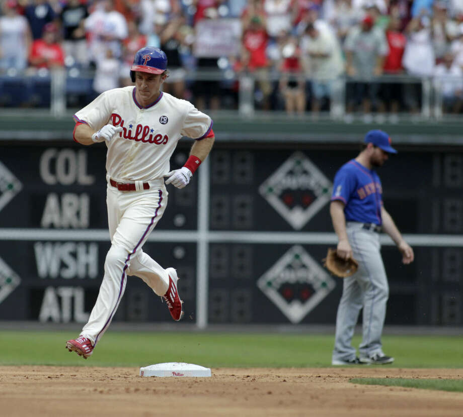 Philadelphia Phillies' Chase Utley runs the bases after he hit a solo home run against the New York Mets in the first inning of a baseball game Sunday, Aug. 10, 2014, in Philadelphia. (AP Photo/H. Rumph Jr)