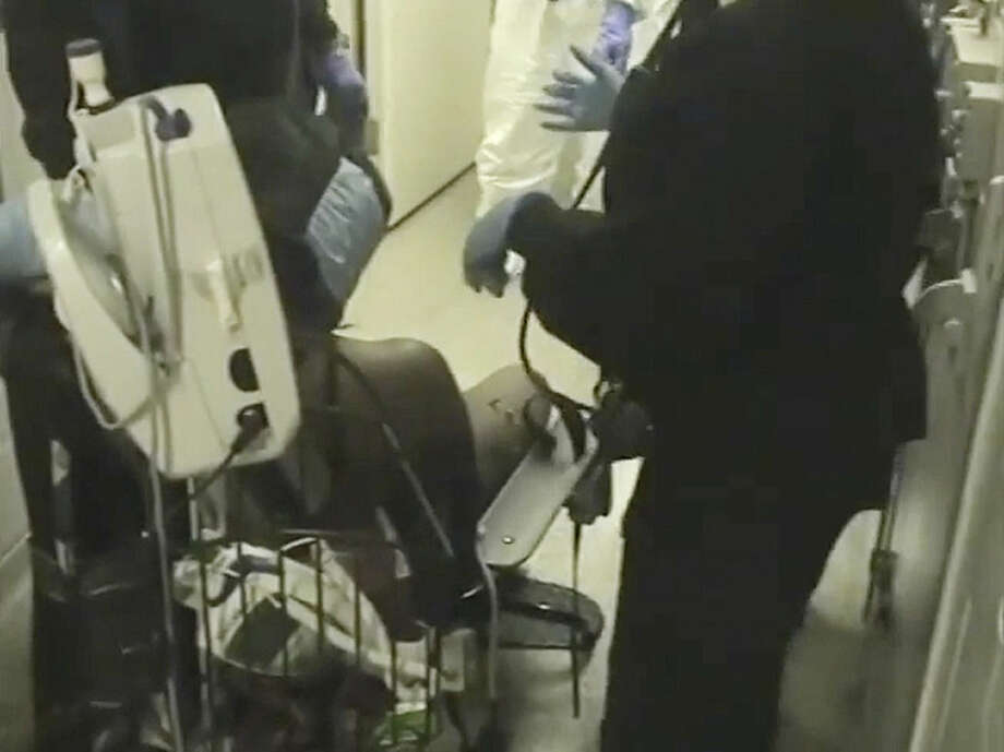 In this Feb. 3, 2015 frame from video provided by the Fairfax County, Va., Sheriff, deputies work to restrain Natasha McKenna during a cell transfer, in Fairfax, Va. The video was released Thursday, Sept. 10, two days after prosecutors said they would not bring criminal charges, shows a prolonged struggle with the mentally ill inmate who died after being shocked with a stun gun. (Fairfax County Sheriff via AP)